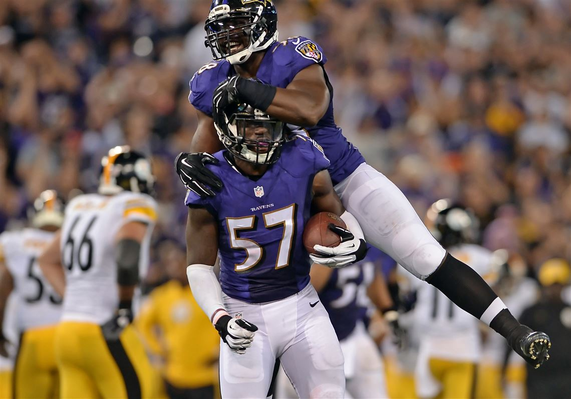8e3fd4127 Ravens linebacker C.J. Mosley is congratulated by Elvis Dumervil after  recovering a fumble against the Steelers