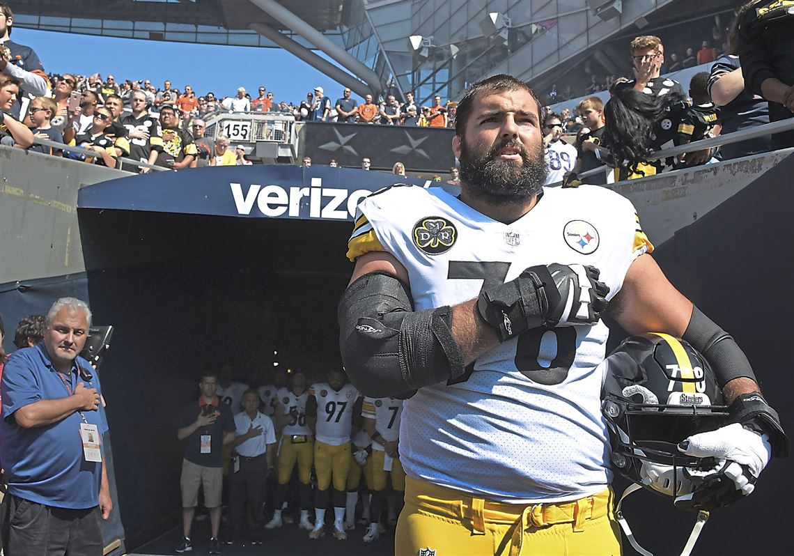 306b423a4 Alejandro Villanueva stands near the tunnel at Soldier Field during the  playing of the national anthem