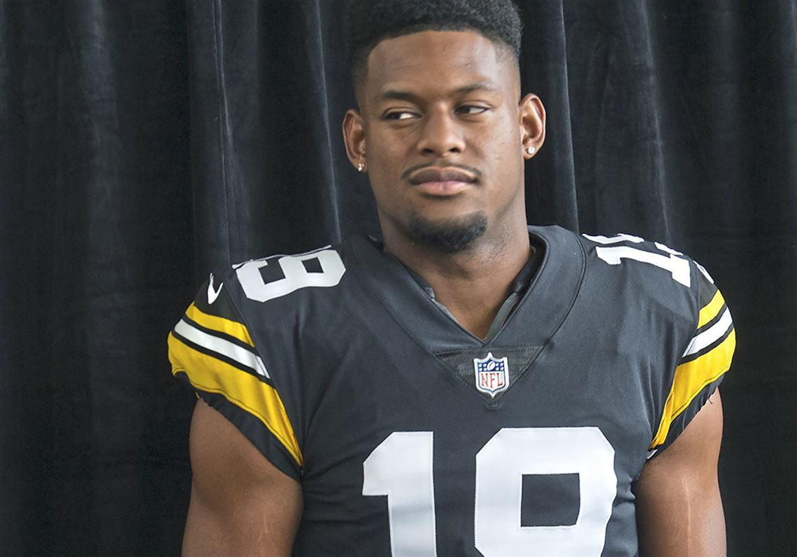 71d582573d1 Wide receiver JuJu Smith-Schuster models the Steelers new throwback jersey.