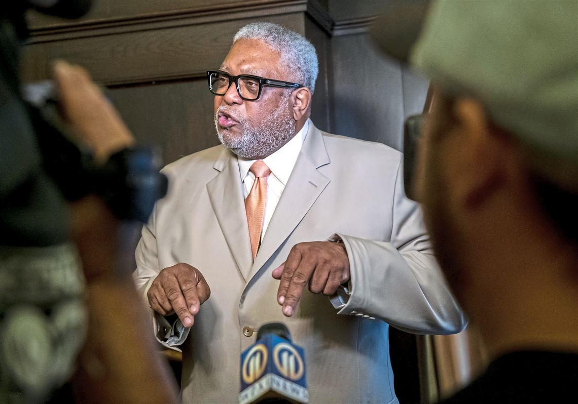 Allegheny County Councilman DeWitt Walton, center, talks about his experiences of protesting police brutality and his own negative experiences with police and why it is important that his resolution to help create a countywide civilian police review board be passed at the Allegheny County Court House on Tuesday July 10, 2018, in Downtown Pittsburgh.