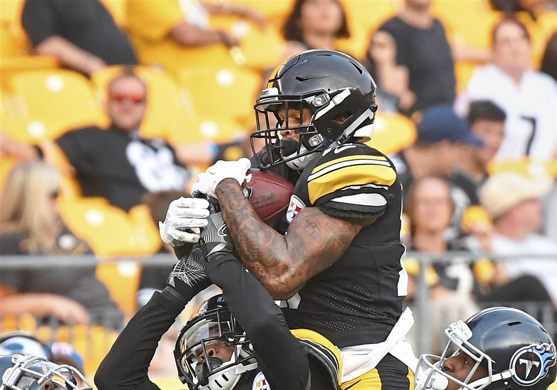 0ee64d6a1 Marcus Allen intercepts pass Saturday against the Titans at Heinz Field.