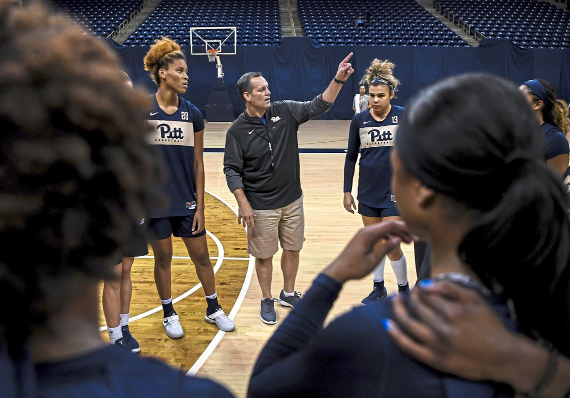 Pitt's women's basketball head coach Lance White huddles with players in  between drills.