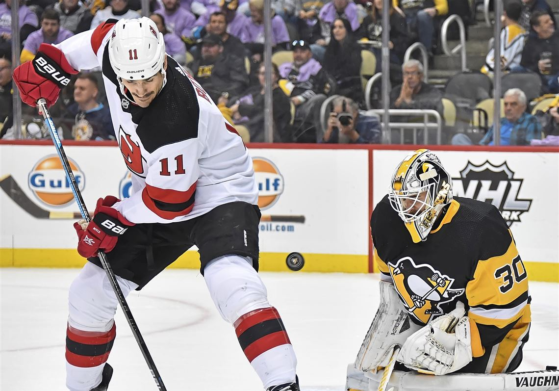9cf0708f6e8 New Jersey Devils winger Brian Boyle tips the puck past Pittsburgh Penguins  goaltender Matt Murray Monday