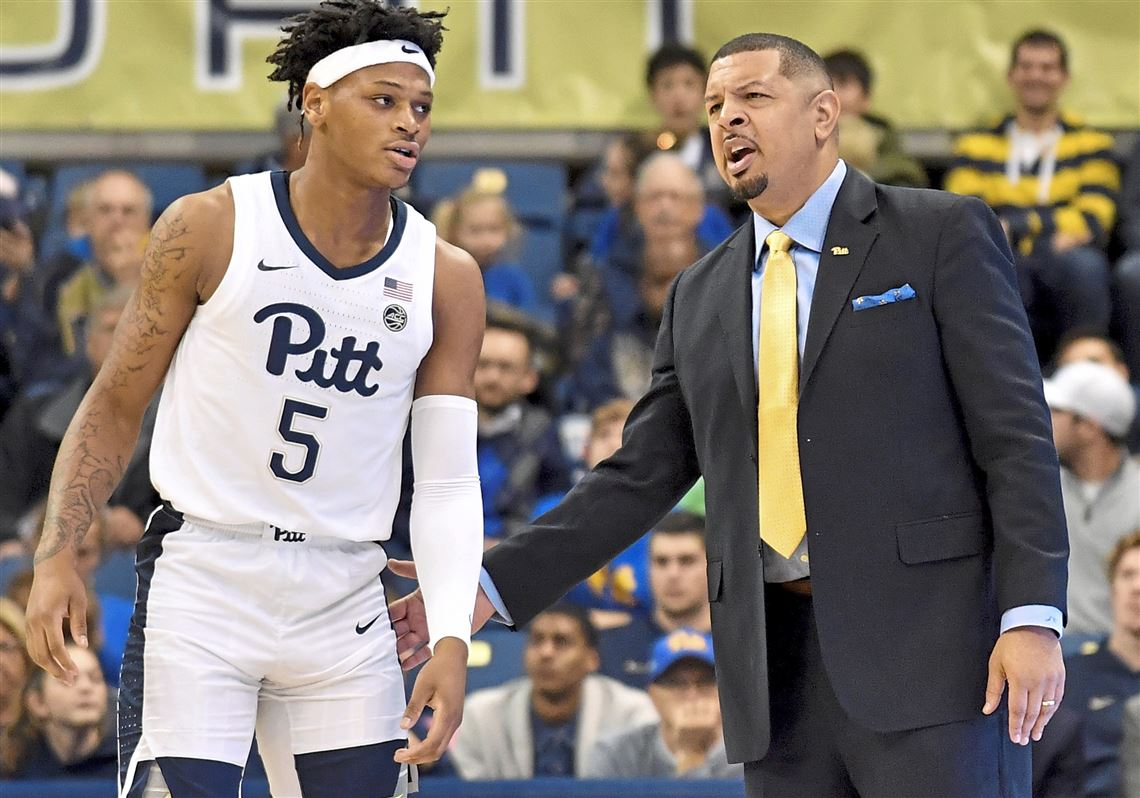 beb65669291 Pitt head coach Jeff Capel talks to guard Au'Diese Toney as they take on. 1