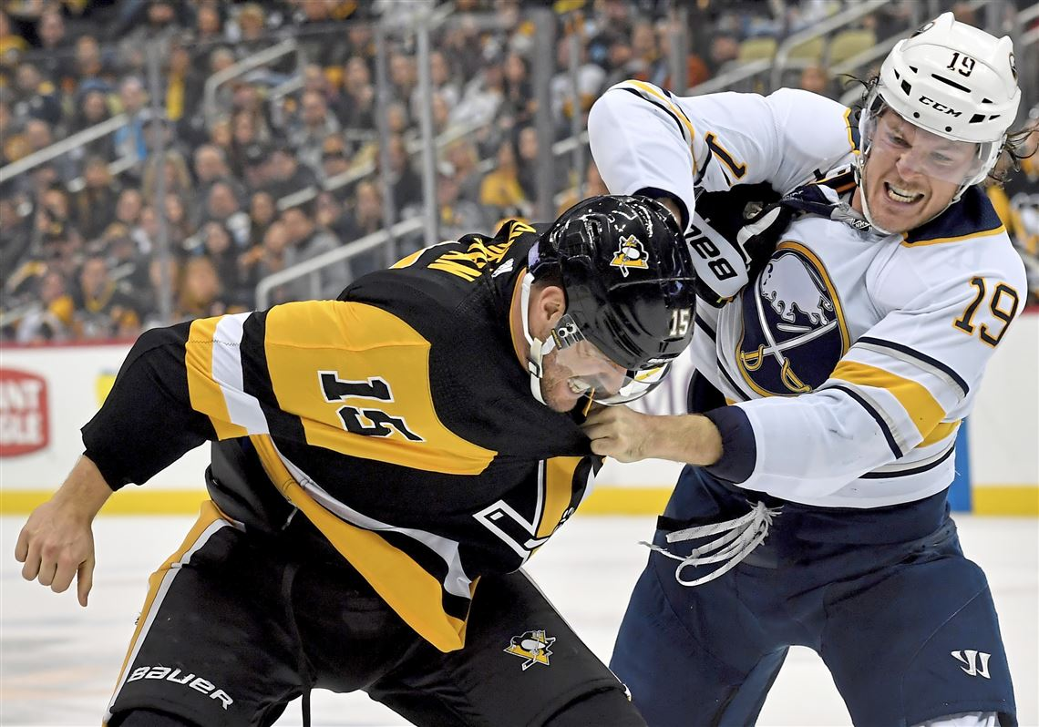 dbc65163ce6 Penguins center Riley Sheahan fights Sabres defenseman Jake McCabe in the  first period Monday