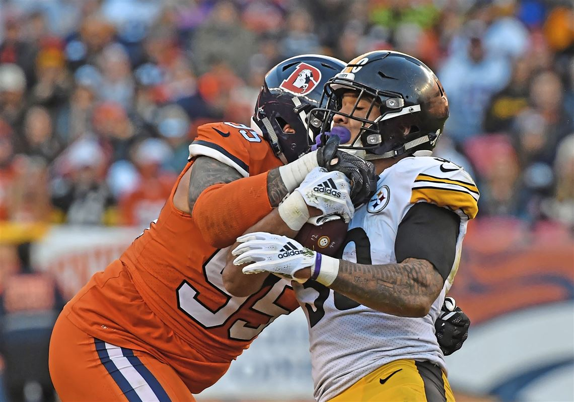 9fea0a482ac Steelers running back James Conner stopped by Denver Broncos defensive end  Derek Wolfe Sunday at Broncos
