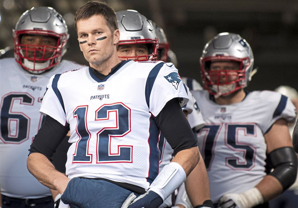f51179aabb1 New England Patriots quarterback Tom Brady  12 makes his way to the field  before the