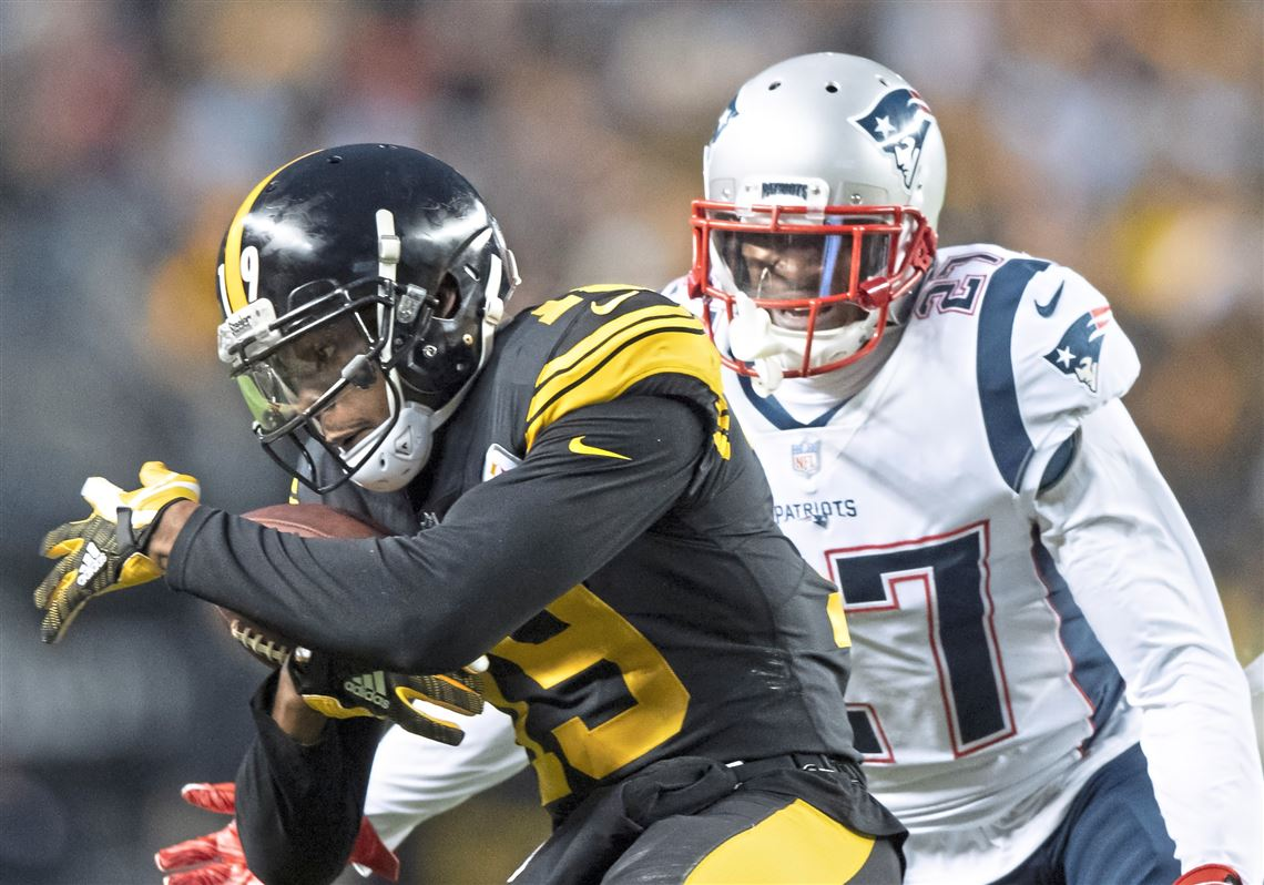 1f3231f1f Steelers receiver JuJu Smith-Schuster catches a pass in front of New  England Patriots defensive