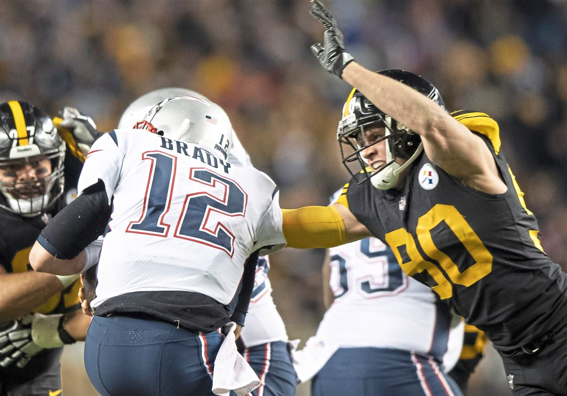 dc25a1bdbc2 New England Patriots quarterback Tom Brady  12 is sacked by Pittsburgh  Steelers outside linebacker T.J.