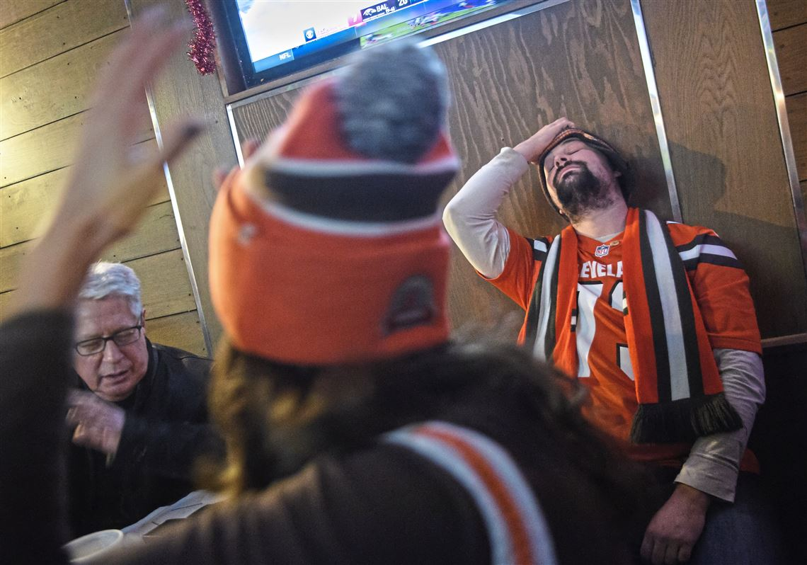 steelers fans and browns fans drinking and cheering together it