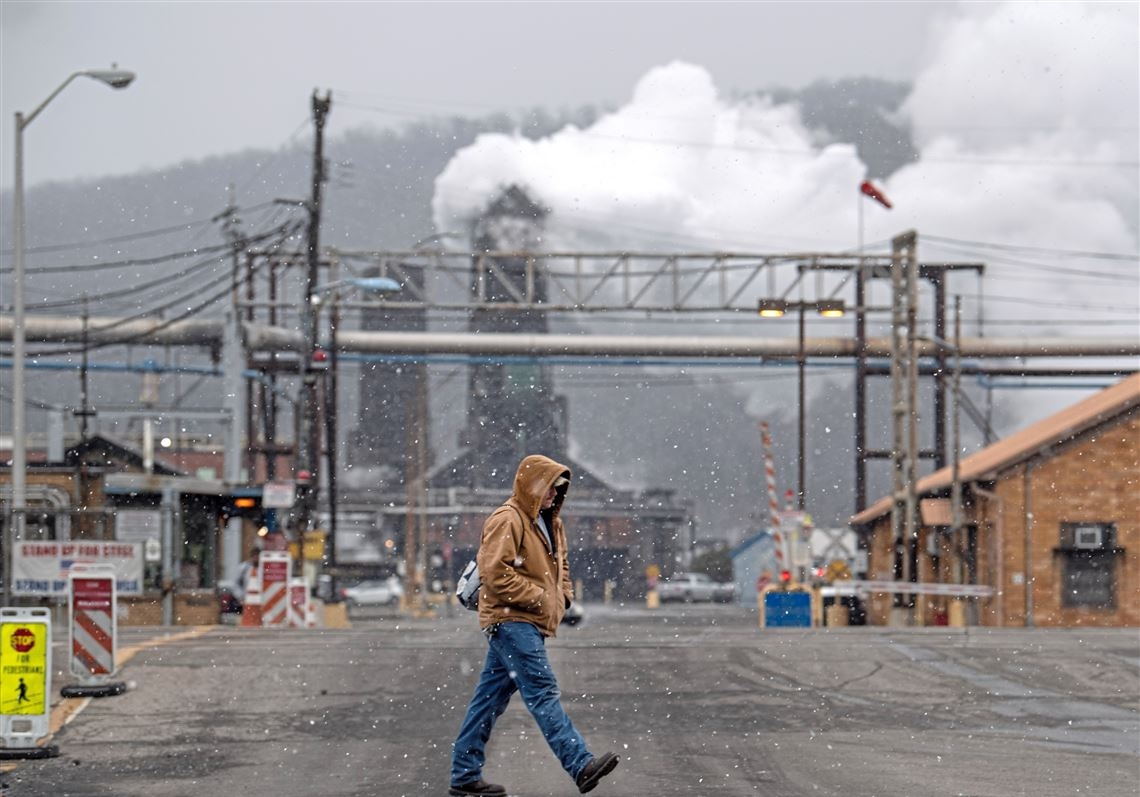 Mike Trumpe of Carroll Township crosses Maple Avenue on Wednesday, Jan. 9, 2019, near U.S. Steel's Clairton Coke Works.