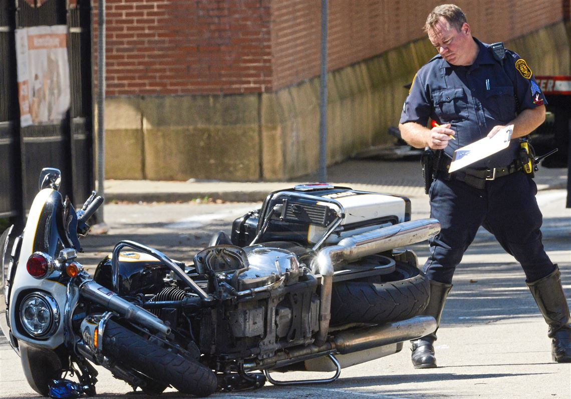 One hurt in two-vehicle crash involving police motorcycle in South Side