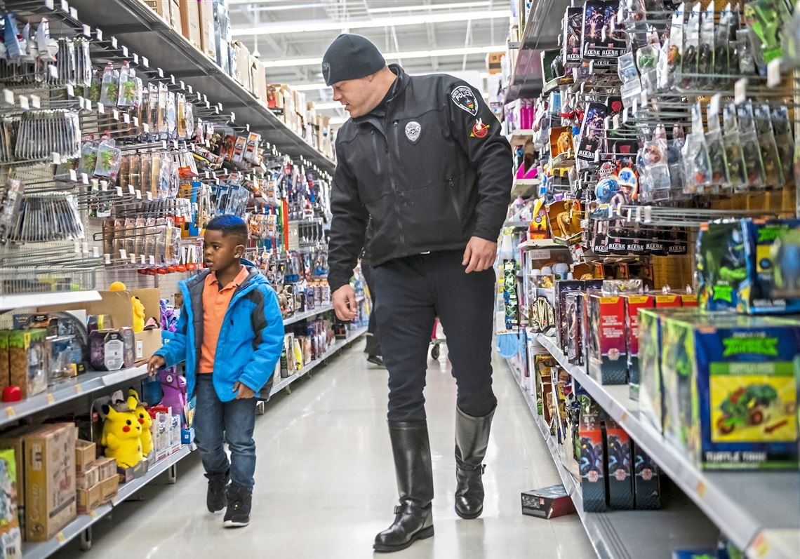 Local families and officers check out the toy aisle at Shop with a Cop 2019