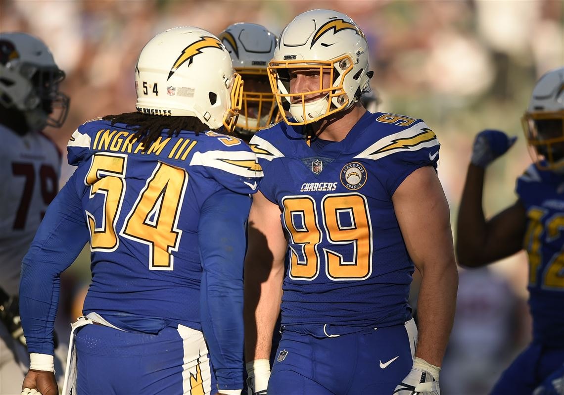 50f94e09af3 Los Angeles Chargers defensive end Joey Bosa (99) celebrates with teammate  Melvin Ingram (