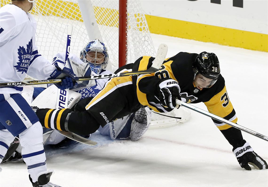 ffc7ee89e12 Pittsburgh Penguins  Derek Grant trips over Toronto Maple Leafs goaltender  Frederik Andersen during the first. 1. MORE