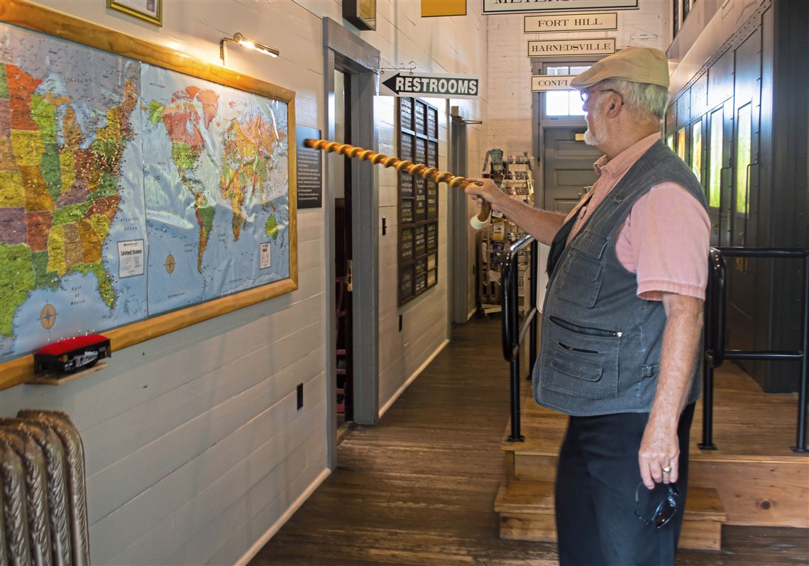 Brooke Folk, of the Meyersdale Historical Society, points to a map to show where visitors to Meyersdale via the Great Allegheny Passage traveled from.