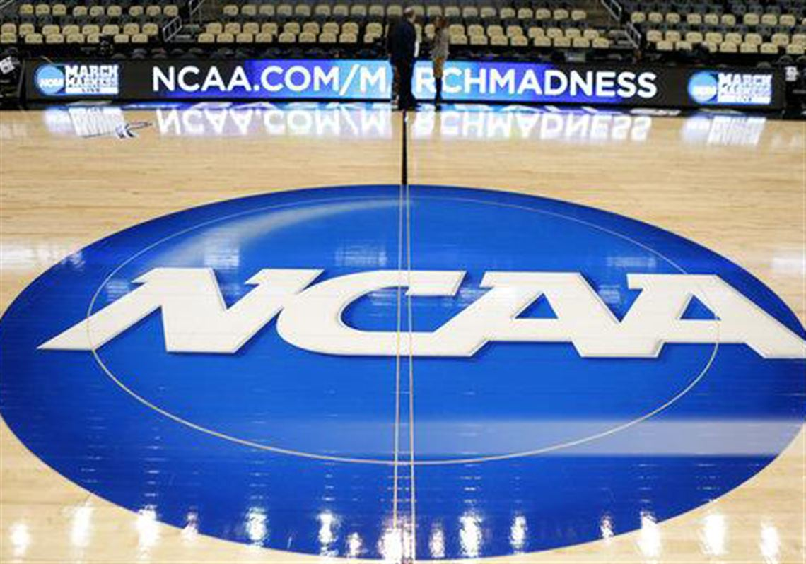 In this March 18, 2015, file photo, the NCAA logo is seen at center court of then-Consol Energy Centerin March 2015.