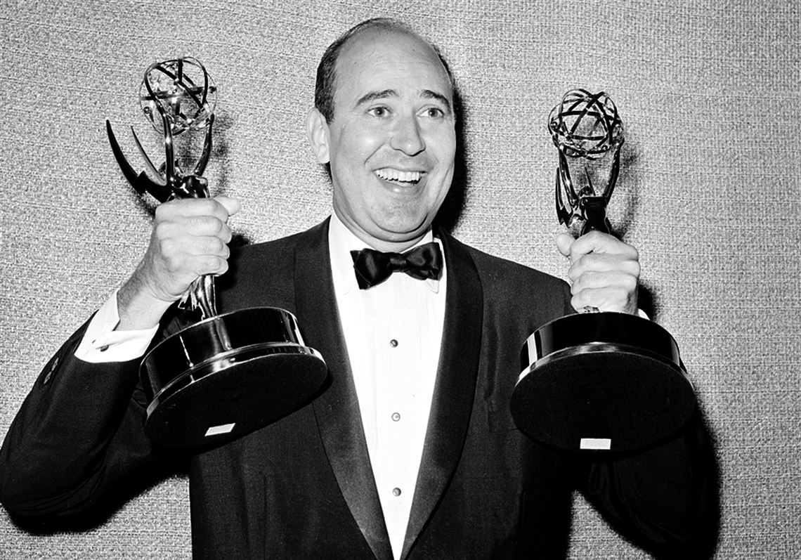 In this May 26, 1963 file photo, Carl Reiner holds two Emmy statuettes presented to him as best comedy writer for the