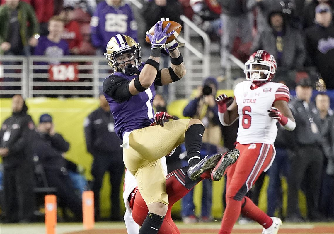 ce90bf08071 Washington defensive back Byron Murphy, left, intercepts a pass against  Utah during the second