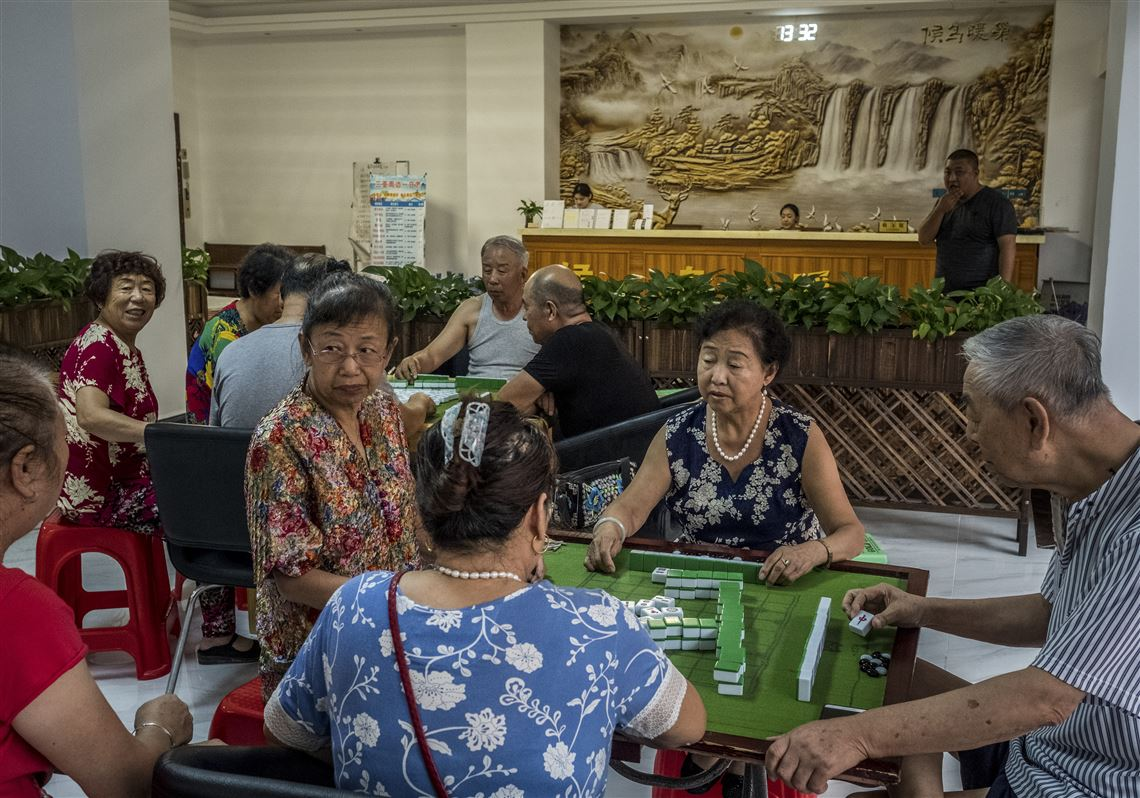 retirees play mahjong at the nuanchao snowbirds retirement apartment in sanya china