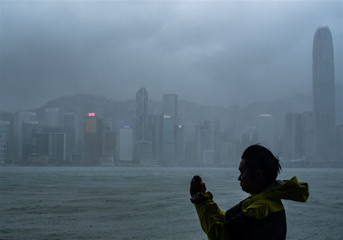 A Man Takes Photos During The Approach Of Typhoon Mangkhut To Hong Kong On Sept