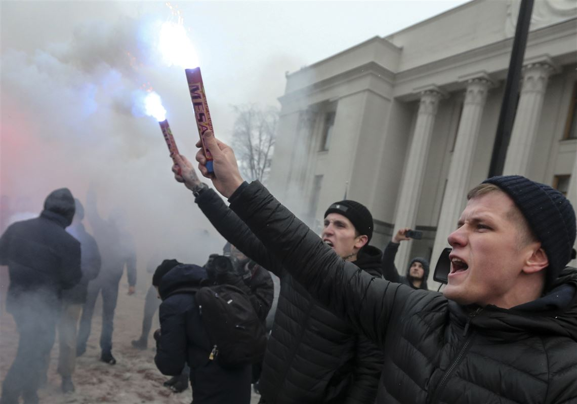 volunteers with the right wing paramilitary azov national corps light flares during a rally on