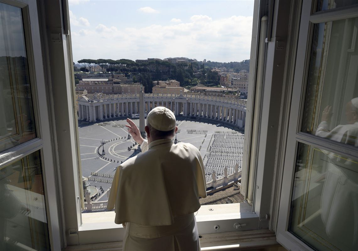 Pope Francis delivers his Sunday blessing from inside the Apostolic library at the Vatican. Francis praised people who risked contagion to help the poor and the homeless, even as fears of the coronavirus's spread prompts ever more countries to restrict ways of everyday life.