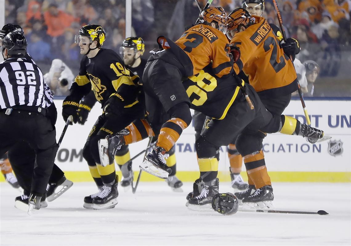 Philadelphia Flyers  Shayne Gostisbehere tackles Pittsburgh Penguins  Kris  Letang as the teams fight during 99eac4da0