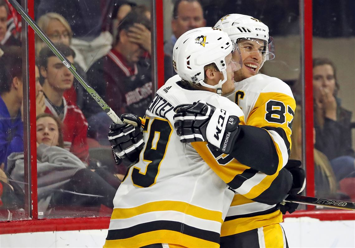 ab478077e46b8 Pittsburgh Penguins  Jake Guentzel (59) is congratulated on his goal by  teammate Sidney