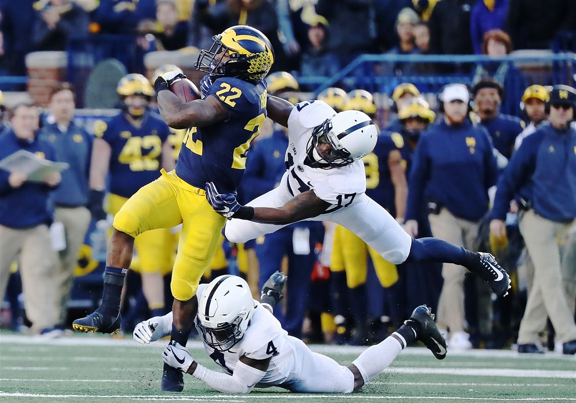 Of The Michigan Wolverines Runs For A Short Gain