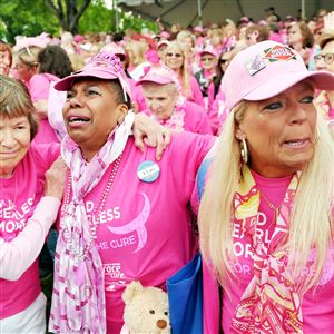 From left: cancer survivors Flo Henderson of Fox Chapel, Karen Tucker-Nibbs of the North Side and Sharon McShane of Sarver embrace Sunday after the survivors march during the Susan G. Komen Race for the Cure at Flagstaff Hill in Schenley Park.