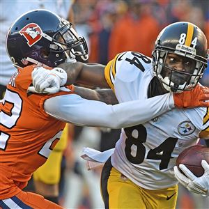 6b86fa389fd Steelers wide receiver Antonio Brown fights off Broncos defensive back  Tramaine Brock on Sunday, Nov