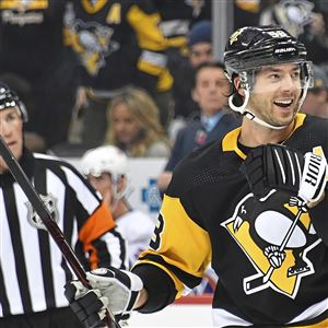 Pittsburgh Penguins defenseman Kris Letang celebrates his second goal of  the first period against the Islanders 8f2ff0c18