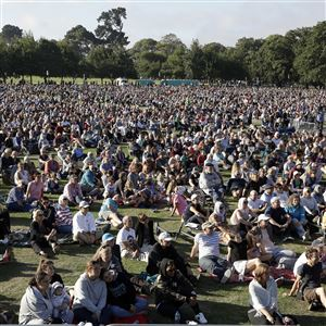 People gather for a vigil in Christchurch's Hagley Park following the March 15 terror attack in New Zealand on March 24, 2019.
