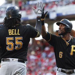af48248ea Pittsburgh Pirates' Starling Marte celebrates with Josh Bell after hitting  a solo home run off