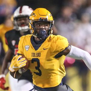 0c0fa5b86be Former Toledo wide receiver Diontae Johnson carries the ball in a game last  season against Ball
