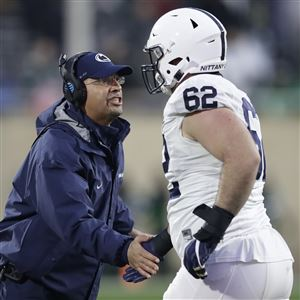 Penn State coach James Franklin greets offensive lineman Michal Menet  during the second half of last ed617dfa2