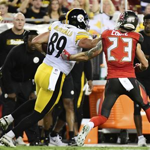 a4cea8dc996 Steelers tight end Vance McDonald stiff-arms Chris Conte on his way to a  touchdown